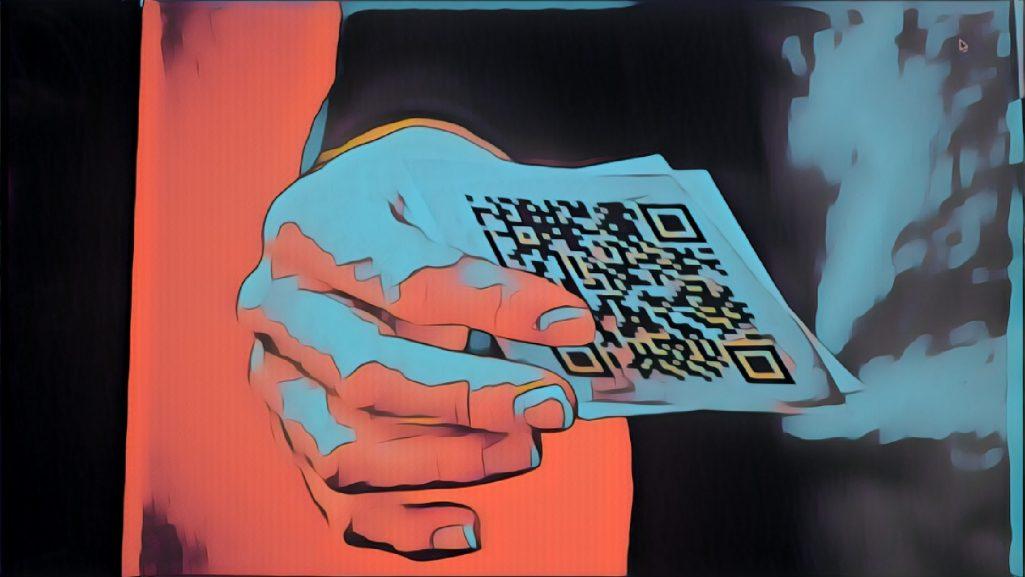 A man holding a QR code
